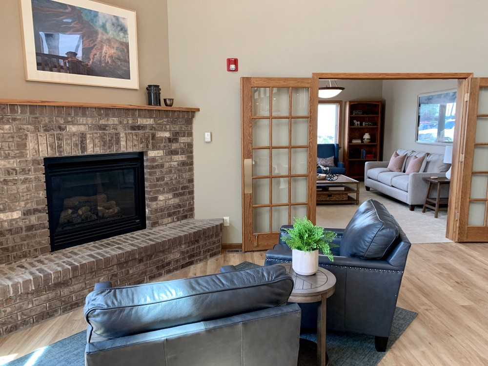 A fireplace and seating area at Autumn Springs.